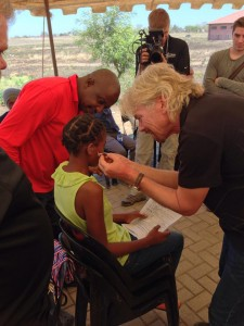 Richard Branson Fitting Hearing Aid